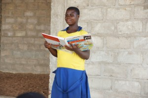 A girl reading in the reading group after school.